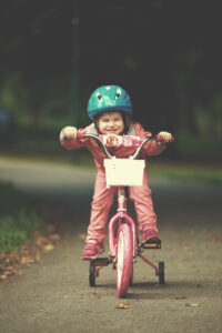little girl with bicycle PCGXPW4