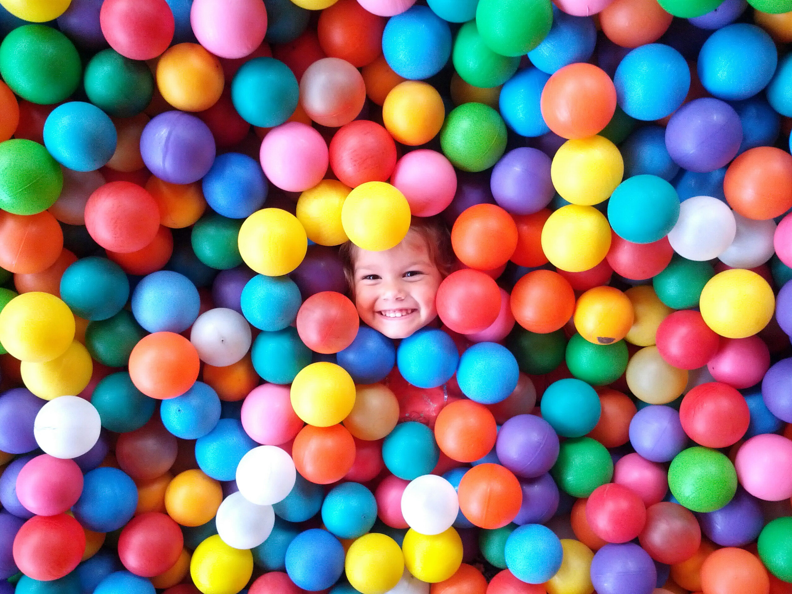 girl playing with colored balls t20 OoYVNb scaled