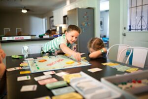 kids playing monopoly game at home t20 8lwplB