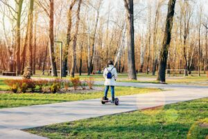 child on hover board kids riding scooter in spring park balance board for children modern gadgets for t20 G0mkNm