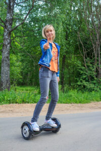 girl on the gyroscooter jeans battery city hoverboard board urban gyroscope asphalt giroscooter legs t20 PQbg0d