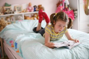 educational toys Girl reading books on moral stories